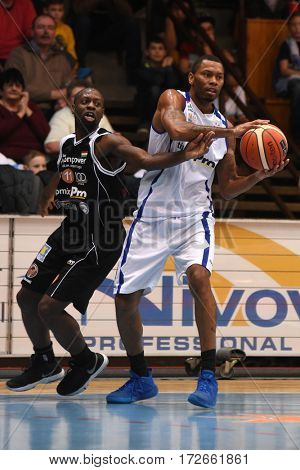 KAPOSVAR, HUNGARY - FEBRUARY 4: Winsome Frazier (in white) in action at Hungarian Championship basketball game with Kaposvar (white) vs. Pecsi VSK (black) on February 4, 2017 in Kaposvar, Hungary.