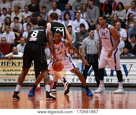 KAPOSVAR, HUNGARY - FEBRUARY 4: Winsome Frazier (white 5) in action at Hungarian Championship basketball game with Kaposvar (white) vs. Pecsi VSK (black) on February 4, 2017 in Kaposvar, Hungary.