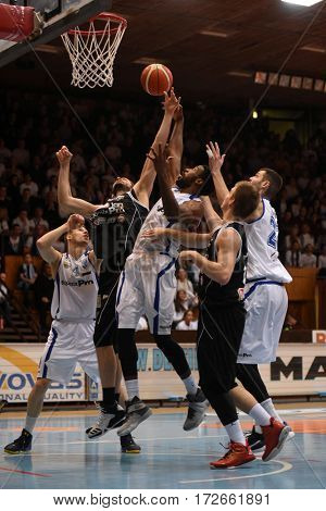 KAPOSVAR, HUNGARY - FEBRUARY 4: Kenneth Simms (in white centrel) in action at Hungarian Championship basketball game with Kaposvar (white) vs. Pecs (black) on February 4, 2017 in Kaposvar, Hungary.