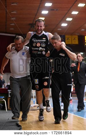 KAPOSVAR, HUNGARY - FEBRUARY 4: Ismet Sejfic (c) injured at Hungarian Championship basketball game with Kaposvar (white) vs. Pecsi VSK (black) on February 4, 2017 in Kaposvar, Hungary.