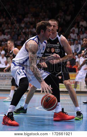 KAPOSVAR, HUNGARY - FEBRUARY 4: Roland Hendlein (white 11) in action at Hungarian Championship basketball game with Kaposvar (white) vs. Pecsi VSK (black) on February 4, 2017 in Kaposvar, Hungary.