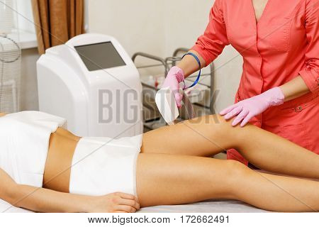 Laser hair removal hip girl. Hardware cosmetology. Cosmetic procedures. Spa.