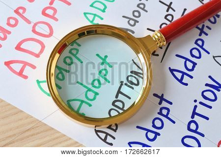 Magnifier and paper with words