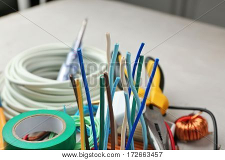 Different wires on blurred background, closeup