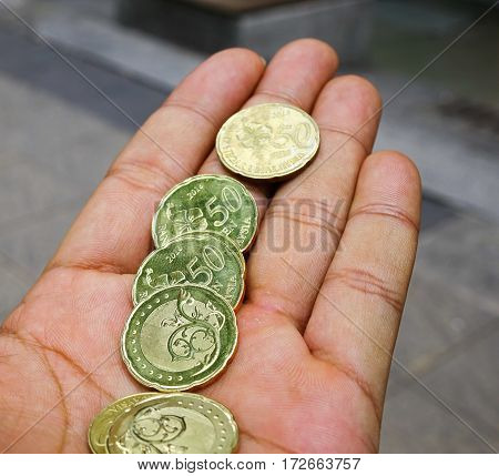 Malaysian Ringgit Coins In The Hand