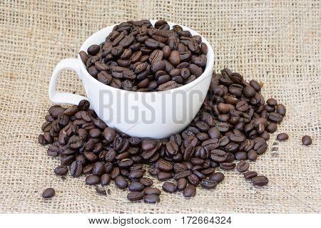 Cup coffee and coffee beans cloth sack background