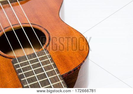 guitar ukulele acoustic music instrument background on white