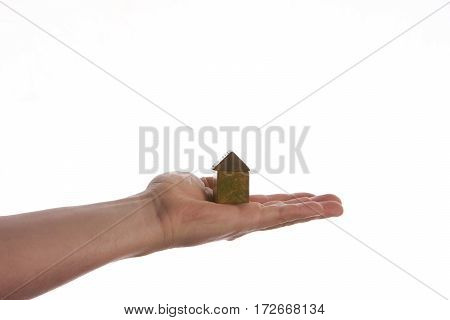 Picture of man hand holding model of a wooden house on isolate white background.