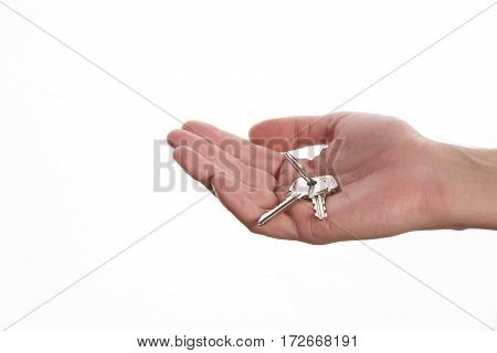 Closeup of hand holding the keys to a new apartment.Isolated on white