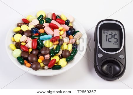 Glucometer With Result Sugar Level And Heap Of Medical Pills And Capsules, Diabetes, Health Care Con