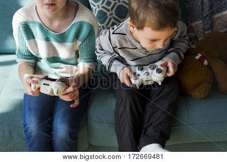 Brother Sister Playing Video Game