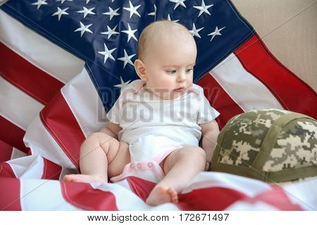 Cute baby with flag and helmet