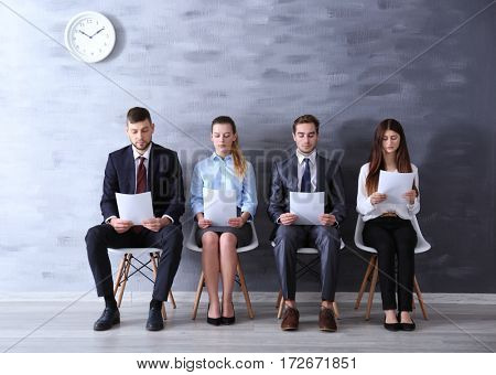 Group of young people waiting for interview indoors