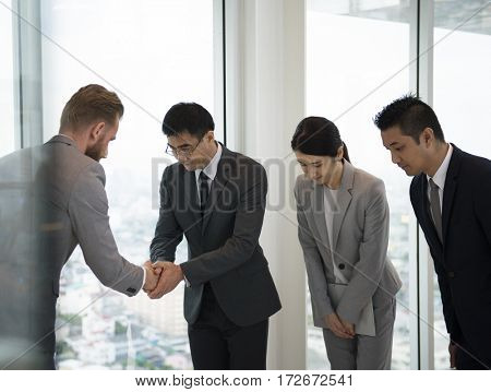 Business Partners Introductionary Handshake Bow