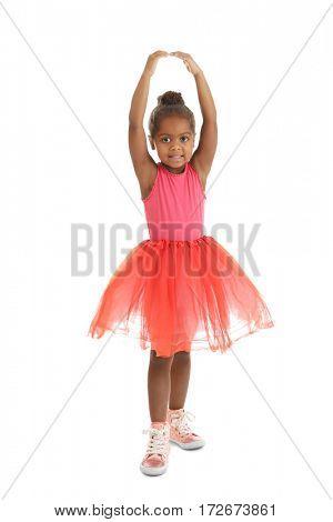 Little African American ballerina on white background