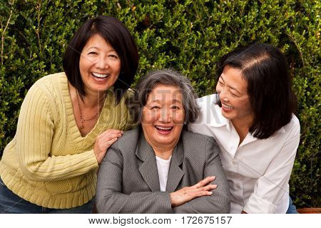 Mature Asian mother and her adult children.
