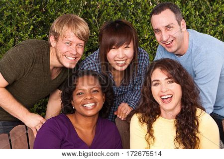 Multicultural group of friends laughing and smiling.