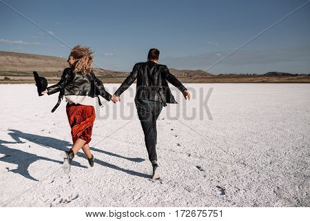 Couple In Love On The Salt Lake. They Ran Back To The Viewer