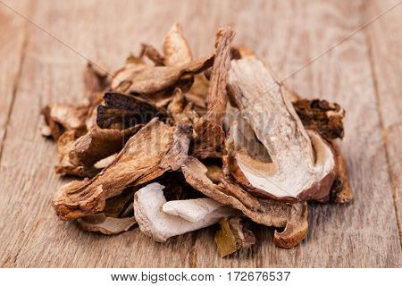 dried mushrooms, on a wooden table