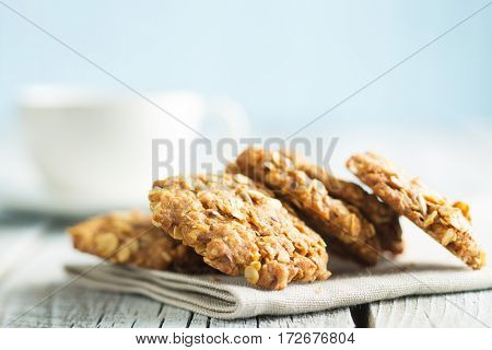 Homemade oatmeal cookies on old wooden table.