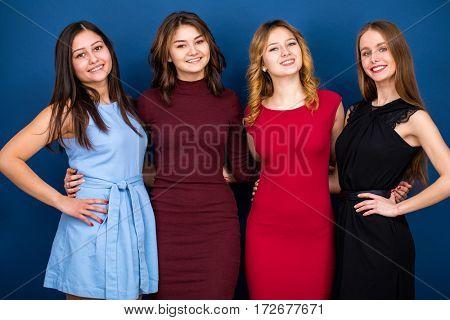 Happy four closeup portrait beautiful women