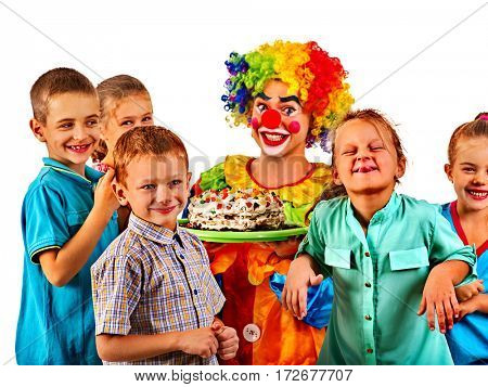Birthday child clown playing with children. Kid holiday cakes celebratory in hands of events organizer man. Fun of group people pose for camera on white background.