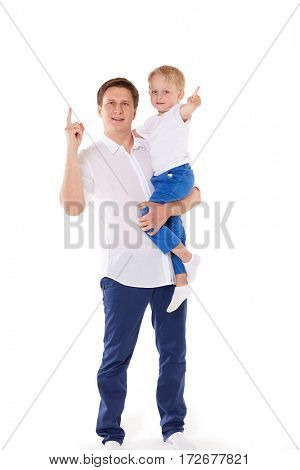 Young happy father with sweet child stands on a white background. Happy family.