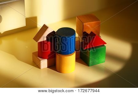 Building block of the desk lighted up by the light of the setting sun