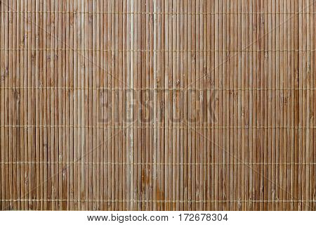 Bamboo napkin mat texture. Wood stripes background. Space for food. Cafe and restaurant decoration.