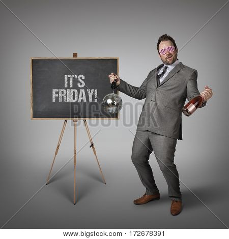 Its Friday text on  blackboard with drunk businessman