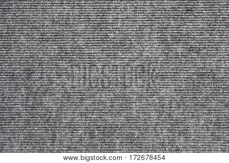 Light grey wool carpet cloth texture for design and background. Floor and home decoration.