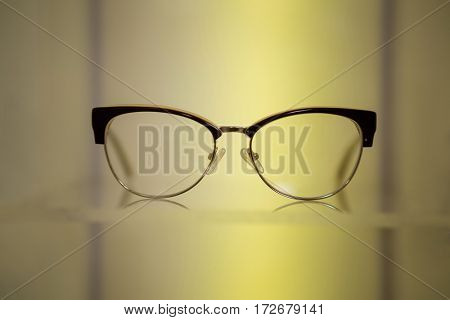 Close-up of spectacles on display in optical store