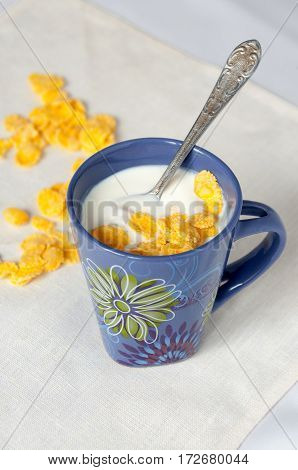 Spoon In A Bowl With Milk And Cornflakes
