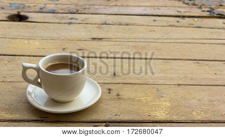 Coffee cup on wooden table cup of coffee
