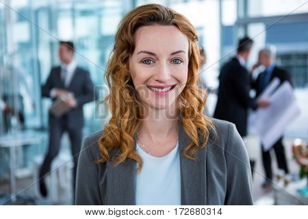 Portrait of smiling businesswoman in office