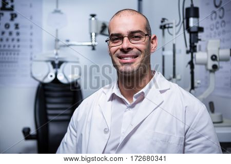 Portrait of male optometrist smiling in ophthalmology clinic