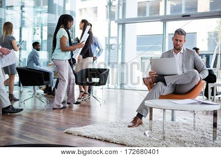 Businessman working on laptop in the office