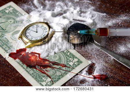 heroin drug powder and a syringe on a background of money blood money