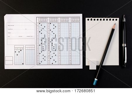 School Exam Answer Sheet And Pen. Standard Test Form Or Answer Sheet. Answer Sheet Focus On Pencil.