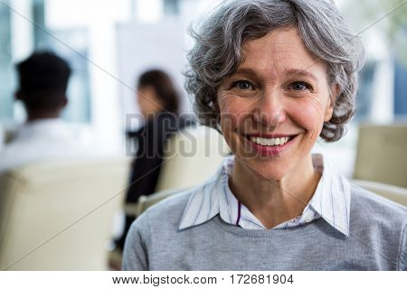 Portrait of smiling businesswoman sitting in office
