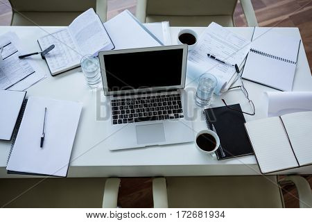 Laptop, organizer and tea on table in office