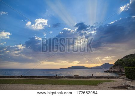 Blue sky and colorful clouds at sunset over Adriatic sea