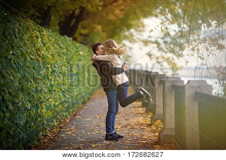 A Young Guy Met His Girlfriend And Raised His Hands. They Are Happy And Smiling. Romantic Mood