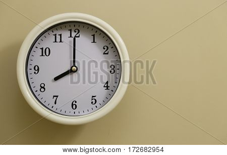 The time for wall clock of the room is 8:00