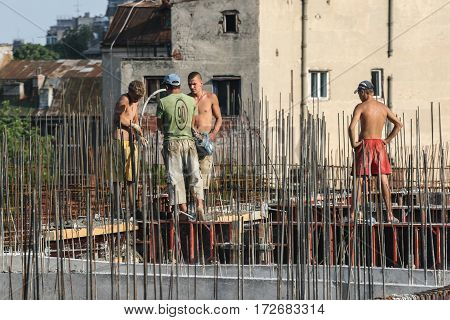 Bucharest Romania June 18 2009: Laborers work at the construction site of a building in Bucharest.