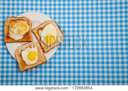 Breakfast. Toast And Eggs On A Blue Table