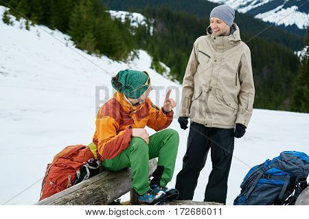 hikers on the trail in the Carpathians mountains at winter