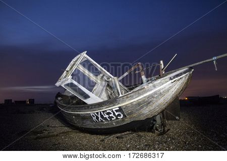 Shipwreck in the dusk on England`s coastline