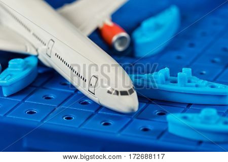 Toy Airliner Crashed Among Toy Warships