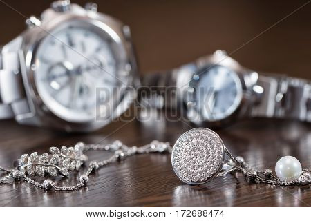 Silver Rings And Chain Lying On Background Chrome Watches